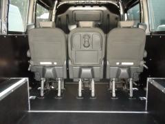 The conversion of the cargo compartment, lining, installation of seats